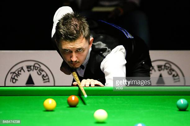 Kyren Wilson of England plays a shot against Xiao Guodong of China in second round match on day three of Indian Open 2016 at Hyderabad International...
