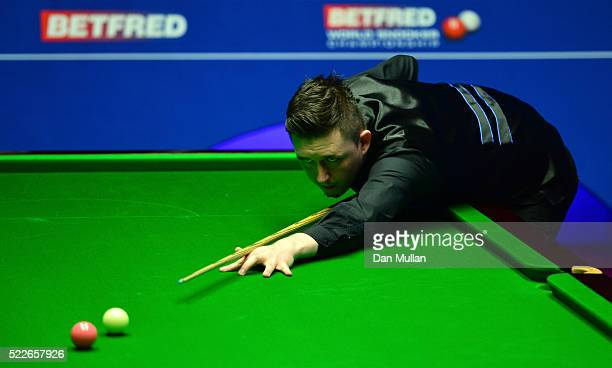 Kyren Wilson of England plays a shot during his first round match against Joe Perry of England on day 5 of the World Snooker Championship at The...