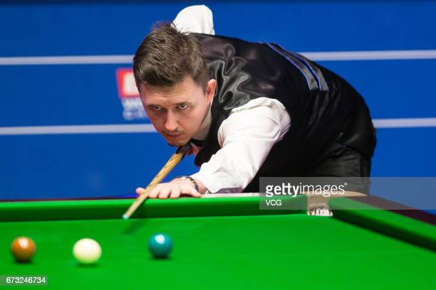 Kyren Wilson of England plays a shot during his quarterfinals match against John Higgins of Scotland on day twelve of Betfred World Championship 2017...