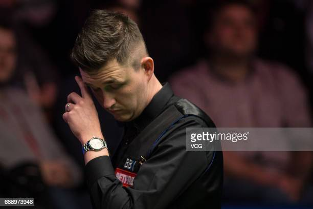 Kyren Wilson of England reacts during his first round match against David Grace of England on day one of the World Championship Snooker at the...