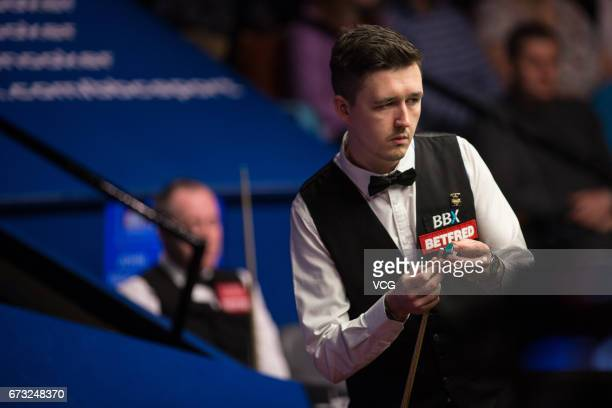 Kyren Wilson of England reacts during his quarterfinals match against John Higgins of Scotland on day twelve of Betfred World Championship 2017 at...