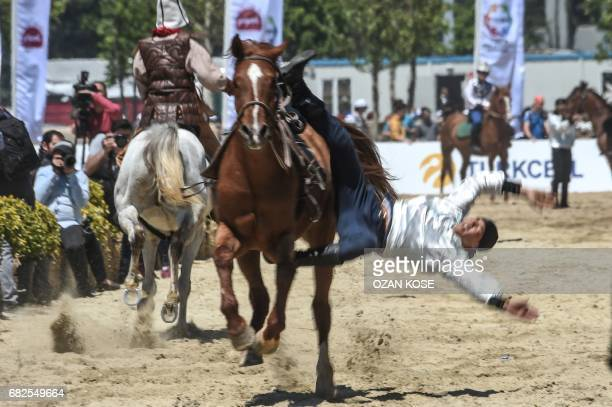 A Kyrgiz acrobat falls from horse on May 11 during the Ethnosports Culture Festival in Istanbul Some 800 athletes gathered in Istanbul for the...