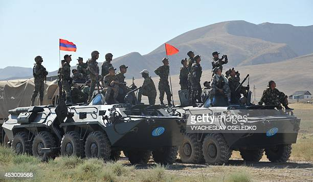 Kyrgyz and Armenian soldiers of Rapid Deployment Forces of the Central Asian nations take part on August 1 2014 in joint military exercises...