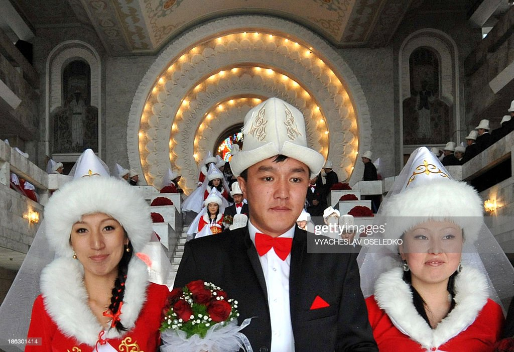 Kyrgyz brides and bridegrooms attend a mass wedding ceremony in the capital Bishkek on October 30, 2013. Fifty couples took part in the mass wedding ceremony sponsored by a state company.