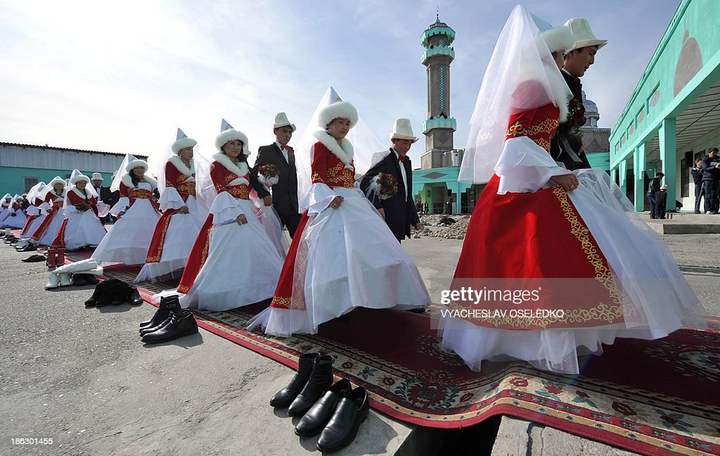 Kyrgyz brides and bridegrooms take part in a mass wedding ceremony in the capital Bishkek on October 30, 2013. Fifty couples took part in the mass wedding ceremony sponsored by a state company.