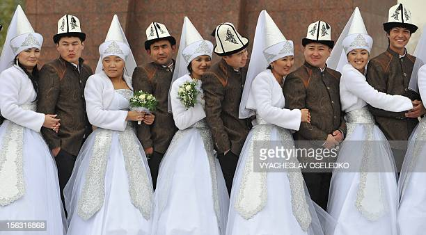 Kyrgyz couples take part in a mass wedding ceremony in the capital Bishkek on November 13 2012 Thirtyfive couples took part in the mass wedding...