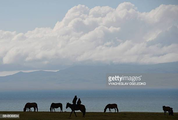 TOPSHOT Kyrgyz men ride a horse during a traditional folk festival at SonKul lake 3016 metres above the sea level some 350 kms from Bishkek on July...