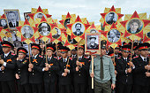 TOPSHOT Kyrgyz military cadets hold portraits of World War Two soldiers as they take part in the Immortal Regiment march in Bishkek on May 9 2016...