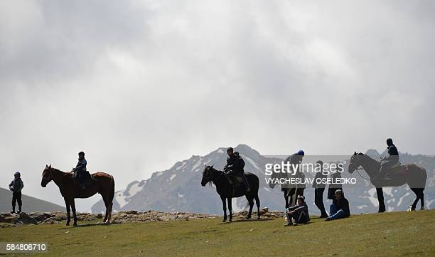Kyrgyz ride horses and sit in the steppe during a traditional folk festival at SonKul lake 3016 metres above the sea level some 350 kms from Bishkek...