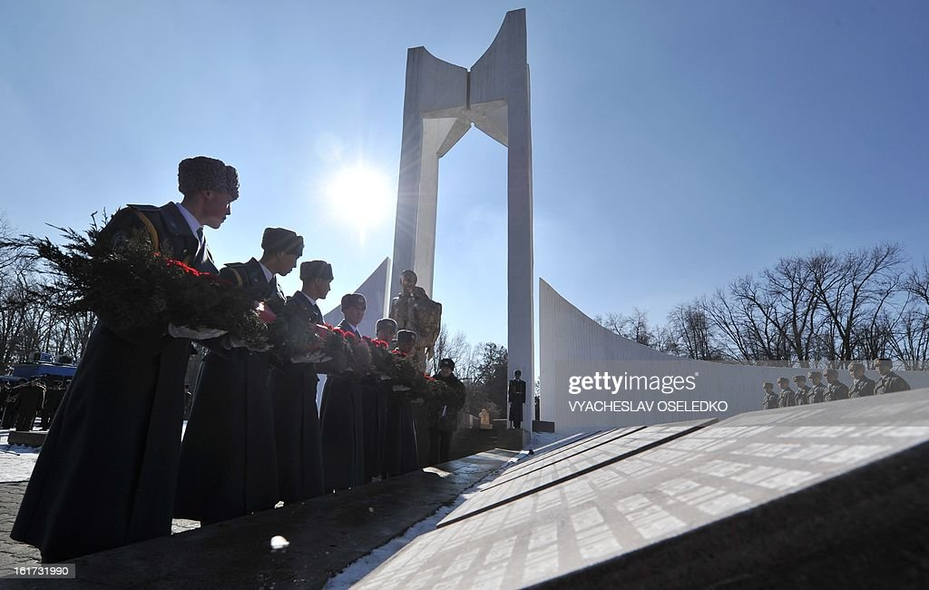 Kyrgyz soldiers lay a wreath at a monument to the Kyrgyzstan born Soviet soldiers killed in Afghanistan while fighting against the Afghan rebels in the 1980s during a commemorative ceremony in the Kyrgyz capital Bishkek on February 15, 2013. The ex-Soviet nation of Kyrgyzstan marked today the 24th anniversary of the Soviet troops withdrawal from Afghanistan.