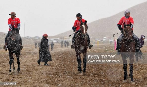 Kyrgyz sportsmen ride during the hunting festival 'Salburun' in the village of Bokonbayevo some 300 km outside Kyrgyzstan's capital Bishkek on...