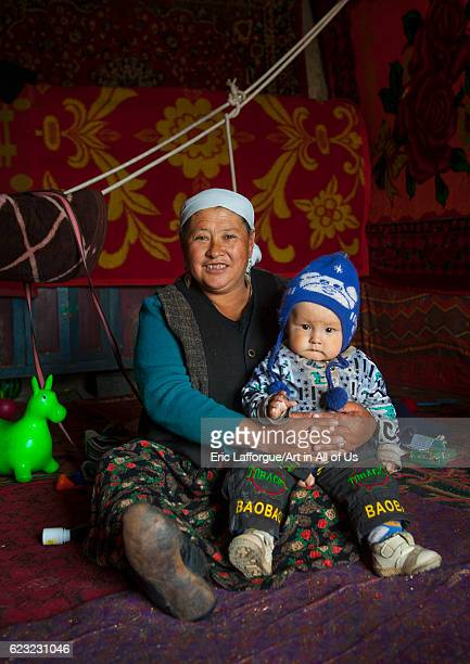 Kyrgyz woman and toddler near Karakul lake Xinjiang Uyghur Autonomous Region China on September 21 2012 in Karakul Lake China