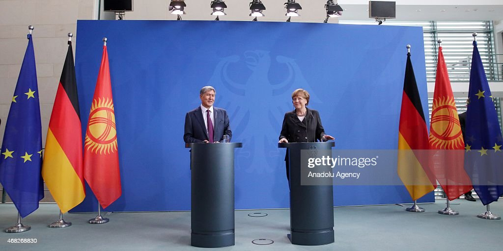 Kyrgyzstan's President Almazbek Atambayev and German Chancellor Angela Merkel are seen during a joint press conference at the German Chancellery on...