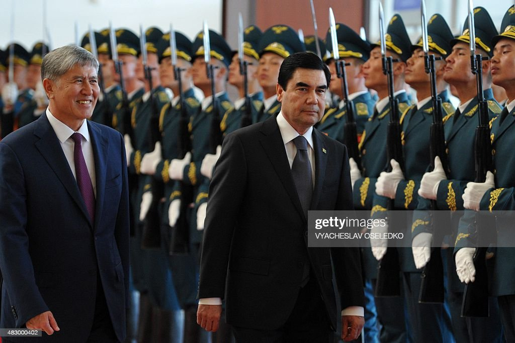 Kyrgyzstan's President Almazbek Atambayev and Turkmenistan's President Gurbanguly Berdymukhamedov review an honour guard during an official welcoming...