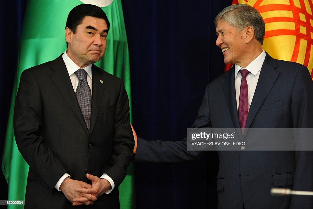 Kyrgyzstan's President Almazbek Atambayev (R) and Turkmenistan's President Gurbanguly Berdymukhamedov attend a signing ceremony at the Ala-Archa state residence in Bishkek on August 5, 2015.
