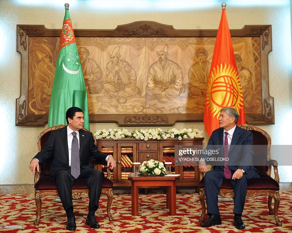 Kyrgyzstan's President Almazbek Atambayev (R) and Turkmenistan's President Gurbanguly Berdymukhamedov talk during their meeting at the Ala-Archa state residence in Bishkek on August 5, 2015.