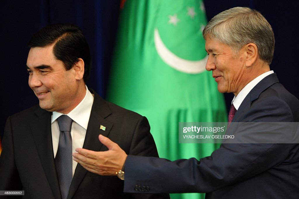 Kyrgyzstan's President <a gi-track='captionPersonalityLinkClicked' href=/galleries/search?phrase=Almazbek+Atambayev&family=editorial&specificpeople=4229890 ng-click='$event.stopPropagation()'>Almazbek Atambayev</a> (R) gestures next to Turkmenistan's President Gurbanguly Berdymukhamedov during a signing ceremony at the Ala-Archa state residence in Bishkek on August 5, 2015. AFP PHOTO / VYACHESLAV OSELEDKO
