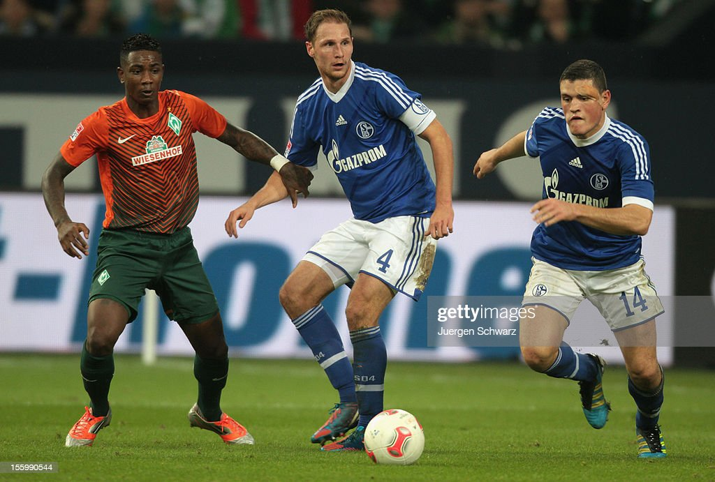 Kyriakos Papadopoulos (R) and Benedikt Hoewedes (C) of Schalke run for the ball beside Eljero Elia of Werder during the Bundesliga match between FC Schalke 04 and Werder Bremen at Veltins-Arena on November 10, 2012 in Gelsenkirchen, Germany.