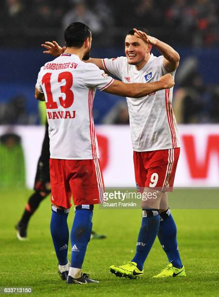 Kyriakos Papadopoulos and Mergim Mavraj of Hamburger SV celebrate after victory in the Bundesliga match between Hamburger SV and Bayer 04 Leverkusen...