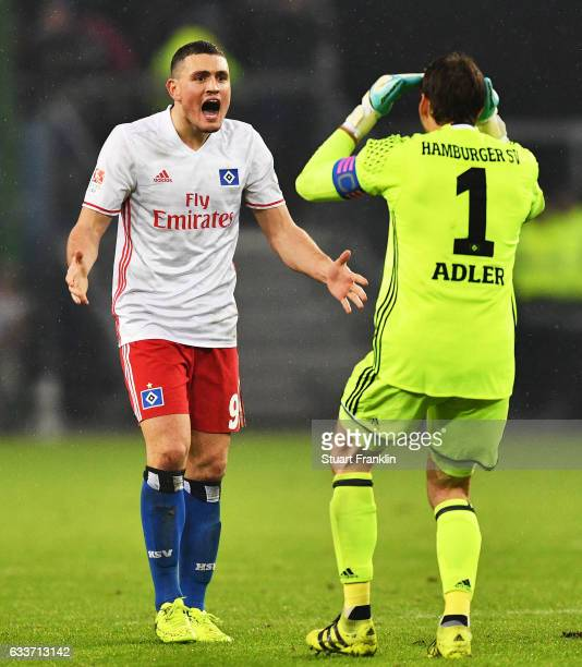 Kyriakos Papadopoulos and Rene Adler of Hamburger SV celebrate after victory in the Bundesliga match between Hamburger SV and Bayer 04 Leverkusen at...