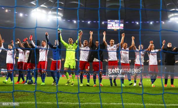 Kyriakos Papadopoulos and Rene Adler of Hamburger SV celebrate with team mates after victory in the Bundesliga match between Hamburger SV and Bayer...