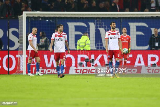 Kyriakos Papadopoulos Dennis Diekmeier Mergim Mavraj and Christian Mathenia of Hamburg look dejected after Bayern scored their first goal during the...