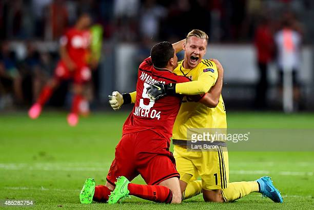 Kyriakos Papadopoulos of Bayer Leverkusen celebrates with Bernd Leno of Bayer Leverkusen during the UEFA Champions League qualifying play off round...