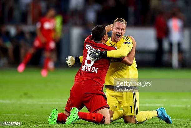 Kyriakos Papadopoulos of Bayer Leverkusen celebrates with Bernd Leno of Bayer Leverkusen during the UEFA Champions League qualifying play off round...