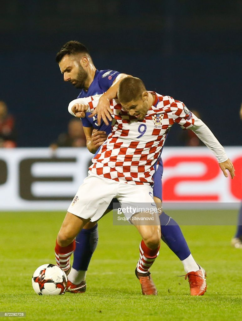 Kyriakos Papadopoulos (L) of Greece is challenged by Andrej Kramaric (R) of Croatia during the FIFA 2018 World Cup Qualifier Play-Off: First Leg between Croatia and Greece at Stadion Maksimir on November 9, 2017 in Zagreb, Croatia