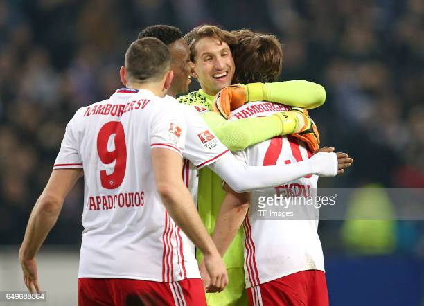 Kyriakos Papadopoulos of Hamburg and Gideon Jung of Hamburg and Goalkeeper Rene Adler of Hamburg and Albin Ekdal of Hamburg celebrate their win after...