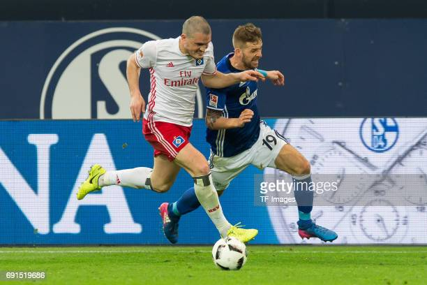 Kyriakos Papadopoulos of Hamburg and Guido Burgstaller of Schalke battle for the ball during to the Bundesliga match between FC Schalke 04 and...