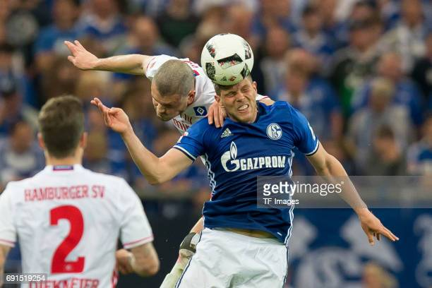 Kyriakos Papadopoulos of Hamburg and KlaasJan HUNTELAAR of Schalke battle for the ball during to the Bundesliga match between FC Schalke 04 and...