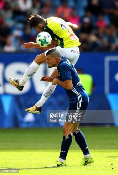 Kyriakos Papadopoulos of Hamburg and Leo Baptistao of RCD Espanyol battle for the ball during the preseason friendly match between Hamburger SV and...