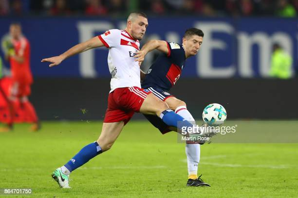 Kyriakos Papadopoulos of Hamburg and Robert Lewandowski of Bayern Muenchen fight for the ball during the Bundesliga match between Hamburger SV and FC...