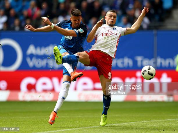 Kyriakos Papadopoulos of Hamburg and Sandro Wagner of Hoffenheim battle for the ball during the Bundesliga match between Hamburger SV and TSG 1899...