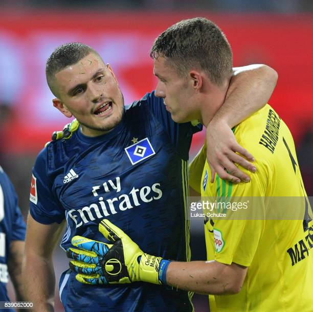 Kyriakos Papadopoulos of Hamburg celebrates with Christian Mathenia of Hamburg after the Bundesliga match between 1 FC Koeln and Hamburger SV at...