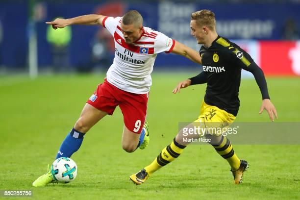 Kyriakos Papadopoulos of Hamburg fights for the ball with Jacob Bruun Larsen of Dortmund during the Bundesliga match between Hamburger SV and...