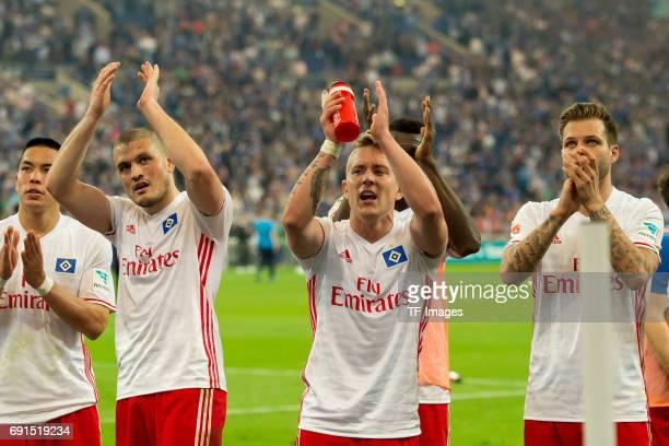 Kyriakos Papadopoulos of Hamburg Lewis Holtby of Hamburg and Dennis Diekmeier of Hamburg looks on during to the Bundesliga match between FC Schalke...