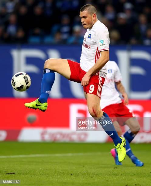 Kyriakos Papadopoulos of Hamburg runs with the ball during the Bundesliga match between Hamburger SV and Borussia Moenchengladbach at...