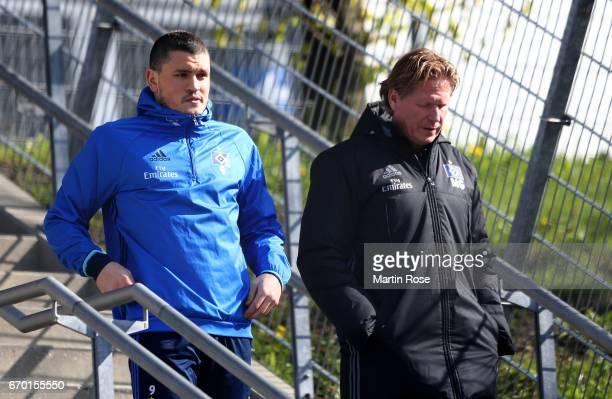 Kyriakos Papadopoulos of Hamburg talks to head coach Markus Gisdol during a training session of Hamburger SV at Volksparkstadio on April 19 2017 in...