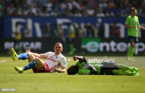 Kyriakos Papadopoulos of HSV and PaulGeorges Ntep of Wolfsburg on the ground during the Bundesliga match between Hamburger SV and VfL Wolfsburg at...