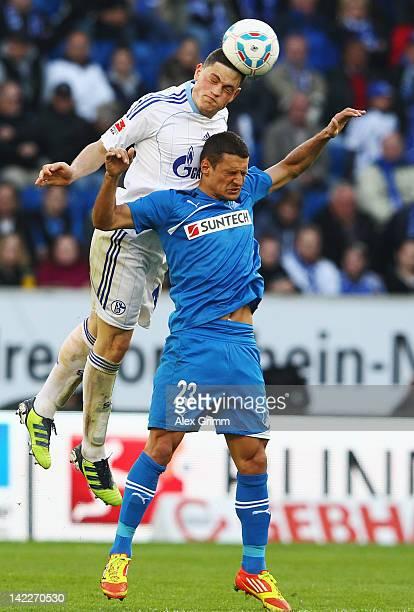 Kyriakos Papadopoulos of Schalke outjumps Sejad Salihovic of Hoffenheim during the Bundesliga match between 1899 Hoffenheim and FC Schalke 04 at...