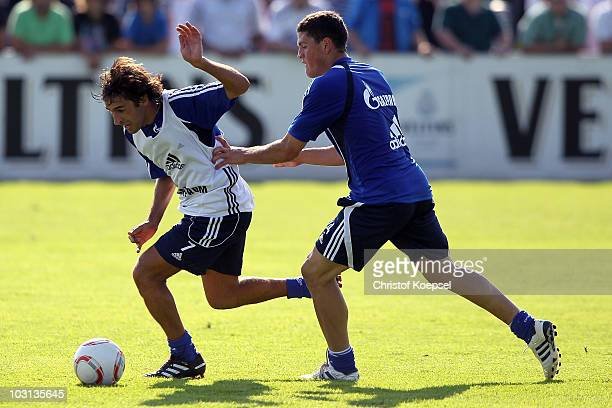 Kyriakos Papadopoulos of Schalke tackles Raul Gonzalez of Schalke during the FC Schalke training session at the training ground on July 28 2010 in...