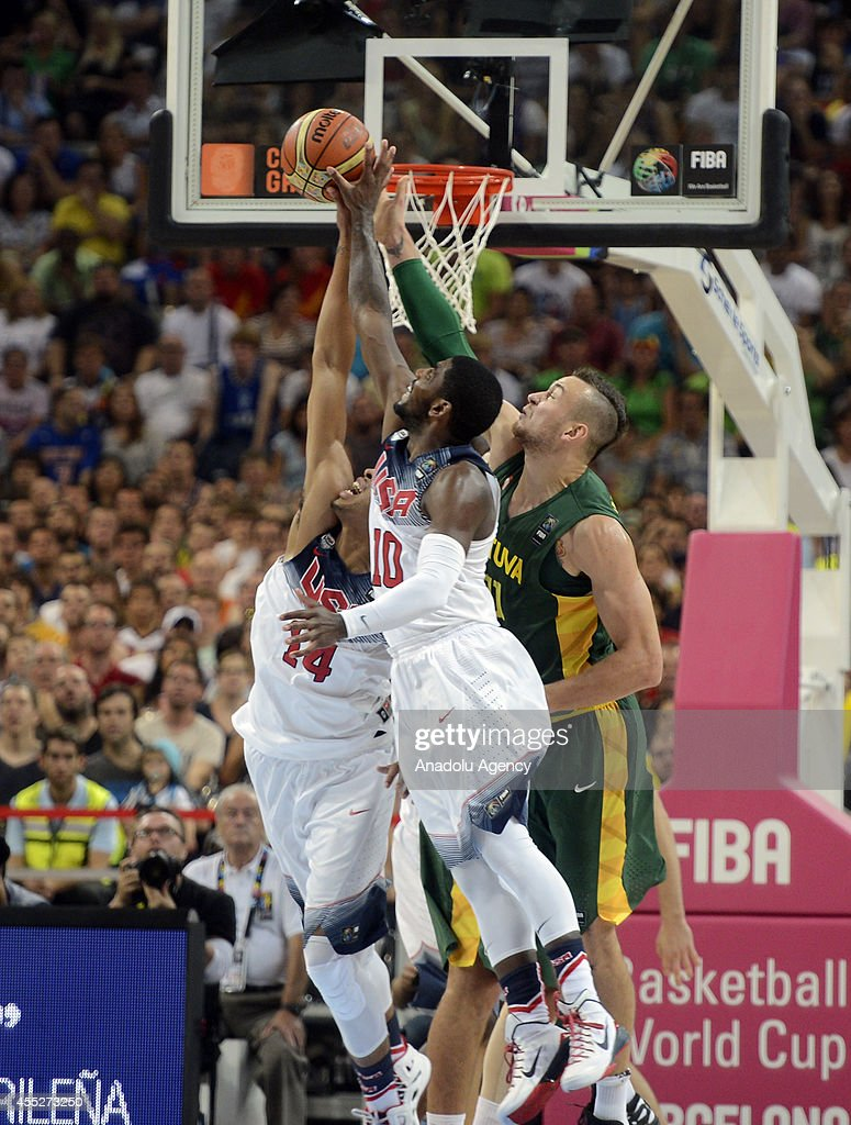 Kyrie Irving and Anthony Davis of USA in action against Donatas Motiejunas of Lithuania during the 2014 FIBA World Basketball Championship SemiFinal...