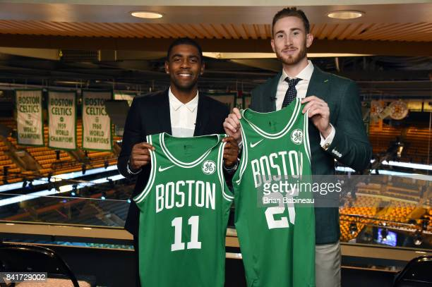 Kyrie Irving and Gordon Hayward pose for a picture holding their jerseys before their introduction as Boston Celtics on September 1 2017 at the TD...
