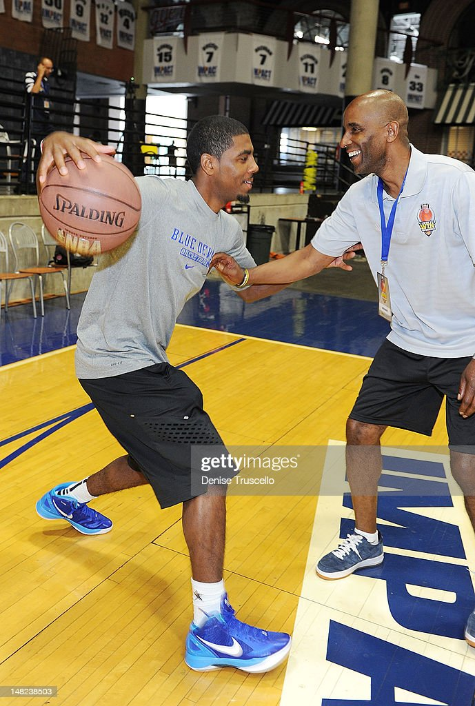 Kyrie Irving and his father Dred Irving during the Jalen Rose Leadership Academy Clinic at Impact Basketball on July 12, 2012 in Las Vegas, Nevada.