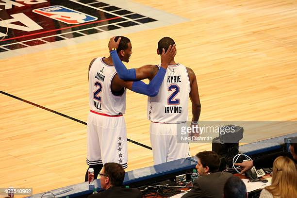 Kyrie Irving and John Wall of the Eastern Conference AllStars talk during the 2015 NBA AllStar Game as part of the 2015 AllStar Weekend at Madison...