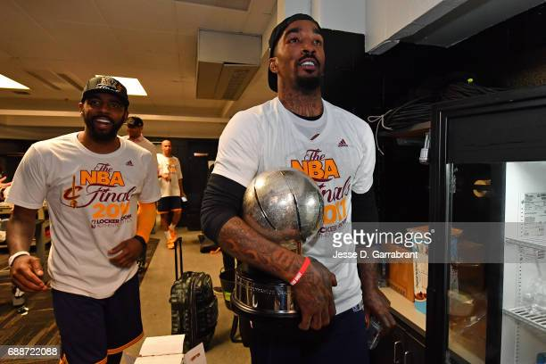 Kyrie Irving and JR Smith of the Cleveland Cavaliers celebrate in the locker room after winning Game Five of the Eastern Conference Finals against...