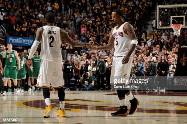 Kyrie Irving and JR Smith of the Cleveland Cavaliers shake hands in Game Three of the Eastern Conference Finals against the Boston Celtics during the...