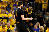 Kyrie Irving and Kevin Love of the Cleveland Cavaliers react in the fouth quarter while taking on the Golden State Warriors in Game 5 of the 2016 NBA...